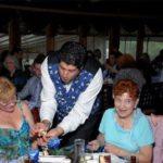 magician performing magic trick at adult party event