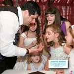 Magician doing trick for young girls