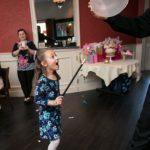 child performing magic trick