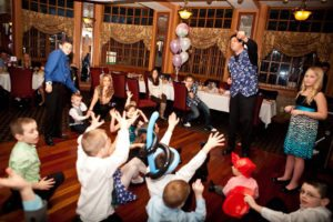 magician entertaining children at party