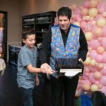 child participating in magic trick